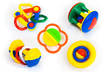 Set of colorful baby rattle toys isolated on white