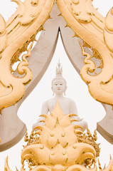 White buddha statue and traditional Thai style molding art.