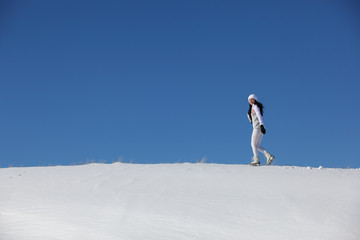 The running girl on snow road to mountains