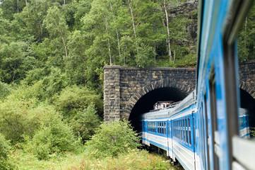 The train drives into a tunnel on Circum-Baikal railroad, Russia