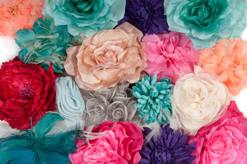 A field of artificial flowers (ladies barrettes with flowers)