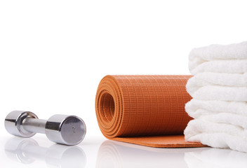 yoga mat, dumbbell and towel with reflex