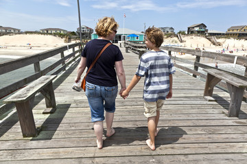 mother and son walking hand in hand