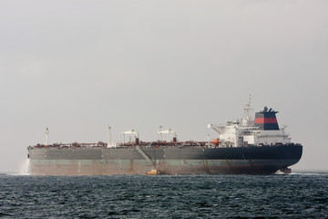 Oil supertanker at sea with Pilot Boat