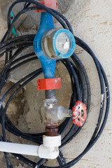 Old dirty water meter and rusting valve
