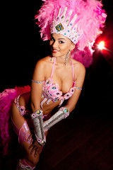 cabaret dancer over dark background