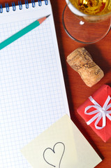 top view of a office workplace with gift, champagne and heart