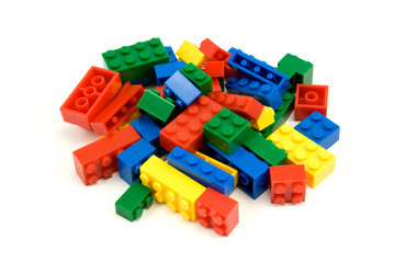 colorful plastic blocks over a white background