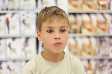 portrait of little caucasian boy looking at side