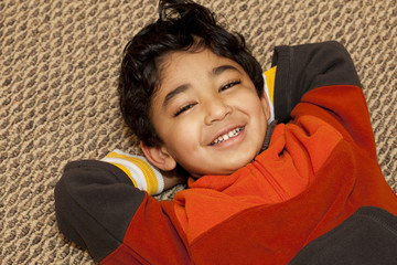 Portrait of a Smiling Toddler On a Carpet