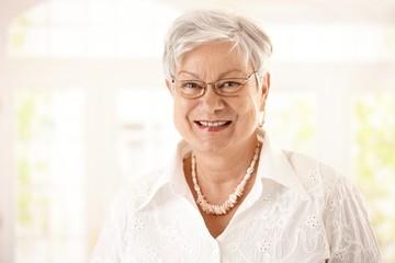 Closeup portrait of happy senior woman