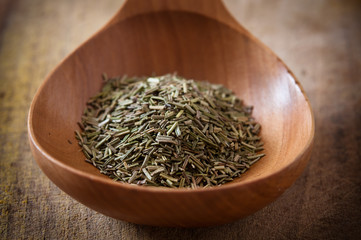 Rosemary on wooden spoon