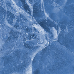 Abstract ice texture. A network of cracks on a piece of ice.