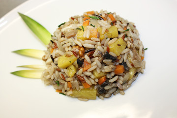 Three-colour rice with pineapple, mushroom, carrot and walnut