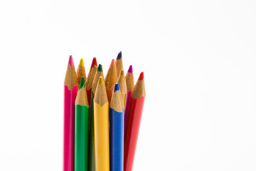 Row of Colored Pencils Against White Background