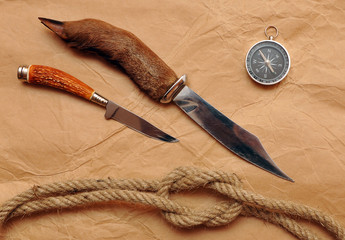 Hunting knife, compass and rope