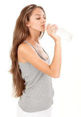 Young brunette beautiful lady drinking gas water in bottle