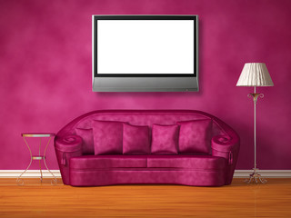 Purple couch with table and standard lamp with lcd tv