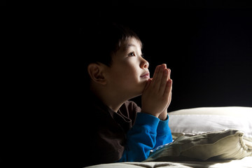 Young boy's bedtime prayer.