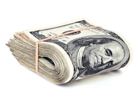 folded hunderd dollar bills