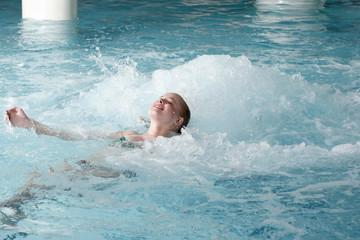 Young woman swimming in spa pool