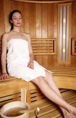 Young woman enjoying a sauna