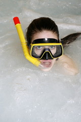 One woman wearing mask and snorkel in jacuzzi at a spa