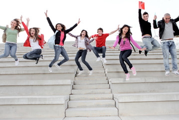 group of school kids jumping