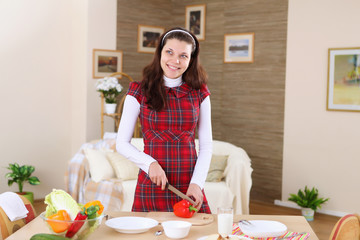 a young girl cooking at home