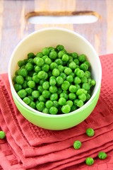 fresh green peas in a cup on the table