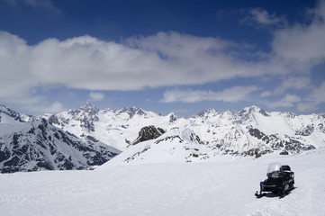 Snowmobile on ski slope