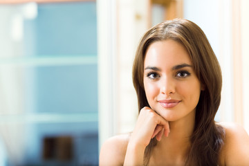 Portrait of young beautiful happy smiling woman, at home