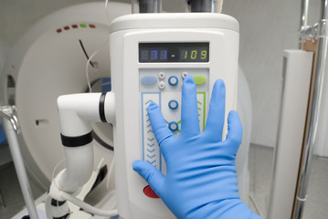 Doctor click an electronic syringe with automatic loading