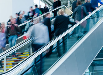 blurred people using a staircase