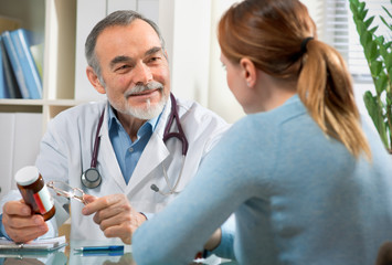 A doctor prescribes a medicine to a young  patient