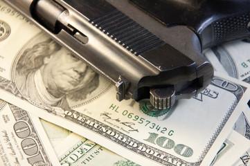 Gun on the dollar-bills