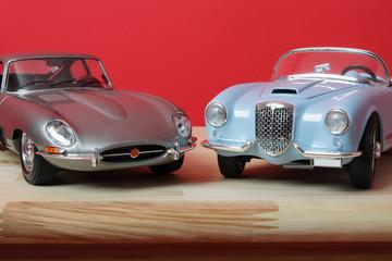 Car models on a desk.