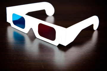 white paper glasses , red and blue