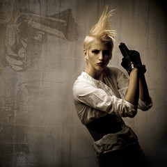 acttractive blond girl with gun