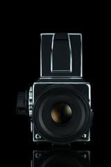 Medium format film camera on black