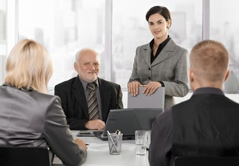 Businesspeople at formal meeting
