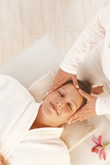 Woman getting relaxing head massage