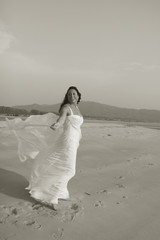 Bride at the beach - b&w.