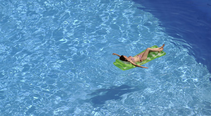 woman relax at swimming pool