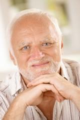 Aged man smiling at camera