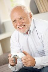 Older man having fun with computer game
