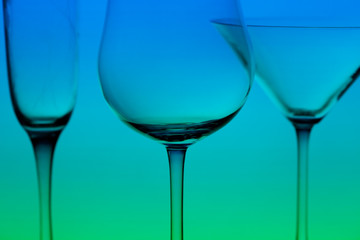 a conceptually illuminated glasses on gradient background