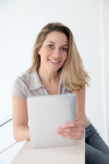 Woman using electronic tablet at home