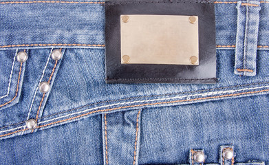 Blue jeans with bronze label