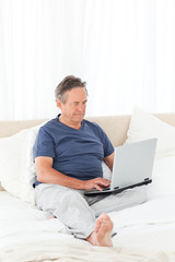 Man looking at his laptop
